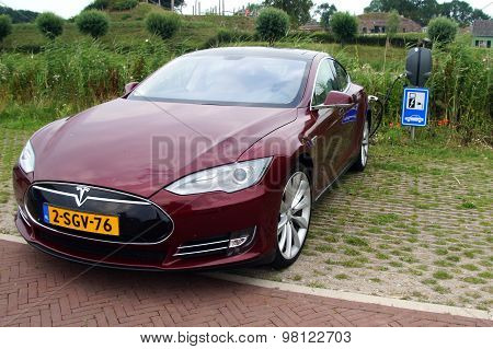 Tesla Model S being charged