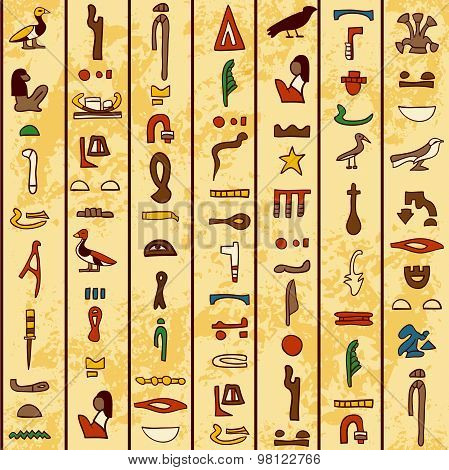 seamless pattern with multicolored ancient Egyptian hieroglyphics on papyrus old paper background