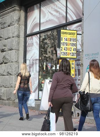 Kiev, Ukraine - September 11, 2013: Passers-by Looking At The Billboard With The Exchange Rate