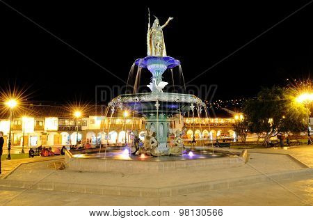 The fountain in Plaza de Armas Cuzco Peru in the night in a long exposure poster