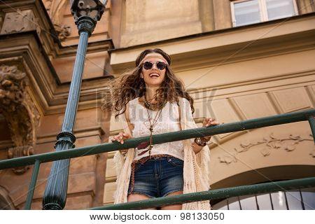 Boho Chic With Sunglasses Near Old Town Streetlight