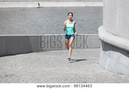 Hispanic Woman Running Uphill