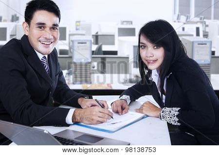 Smiling Businesspeople After Signing Business Contract