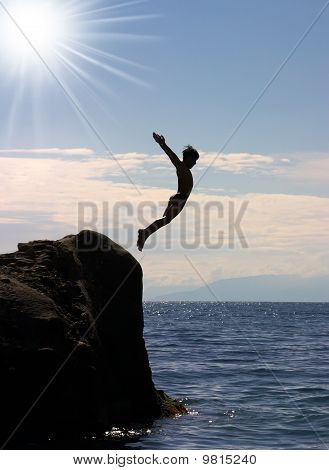 boy jumping to the sea