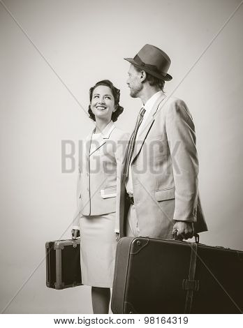 Elegant couple leaving for vacations with luggage 1950s style poster