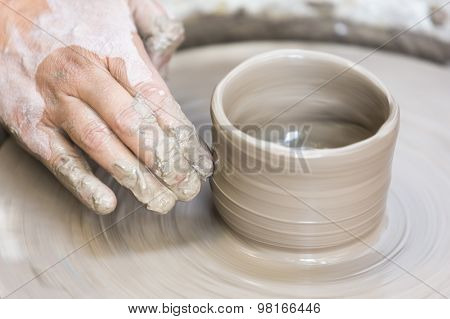 Making A Pottery Cup On The Wheel