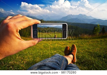 Man Taking A Photo Of A Landscape With His Phone - Point Of View