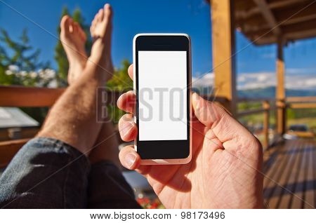 Man With Smartphone In His Hand On Balcony. Point Of View.