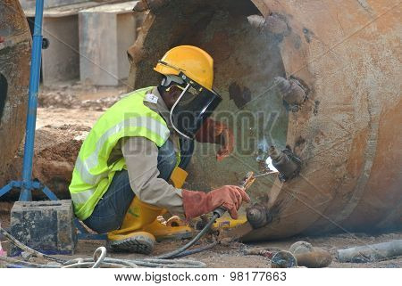 Licence welder repair bore pile auger at construction site