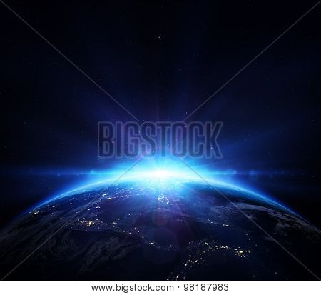 planet earth with sunrise in the space - horizon blue shining in Usa