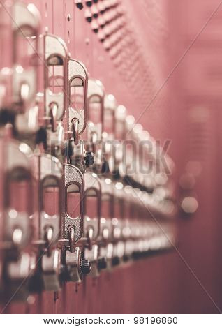 Red lockers arranged neatly from a side view