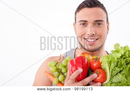 Handsome young fit guy prefers healthy eating