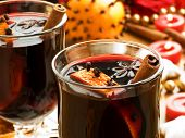 Mulled wine with slice of orange and spices. Shallow dof. poster
