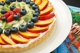 Mouth Watering Cake With Fresh Fruits On A Plate