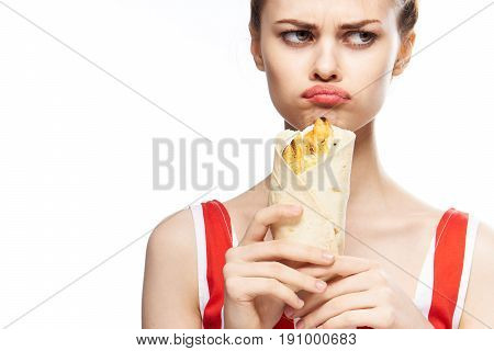 Woman is hungry, woman is holding pita bread on isolated background.