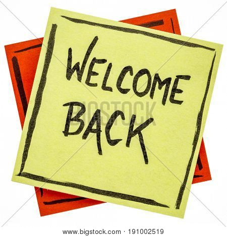 welcome back - handwriting on a sticky note isolated on white
