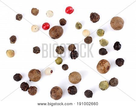 black pepper. peppercorns isolated on white background. top view