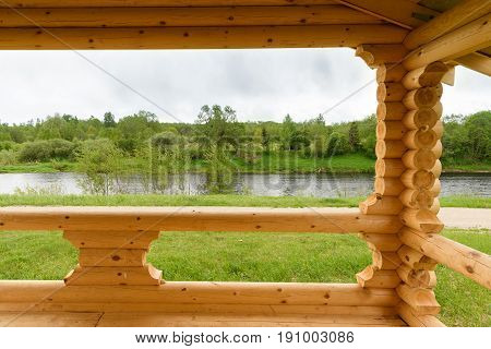 The View From The Verandas Of The Houses Are Built Of Logs On The River And The Opposite Bank Of The
