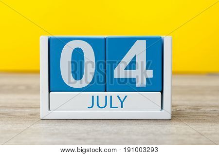 July 4th. Image of july 4 calendar on yellow background. Summer day. Empty space for text. Independence Day Of America.