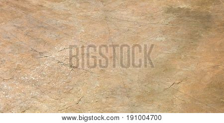 Summer. Construction works. Old multi-colored rough cement screed. Color brown yellow red white