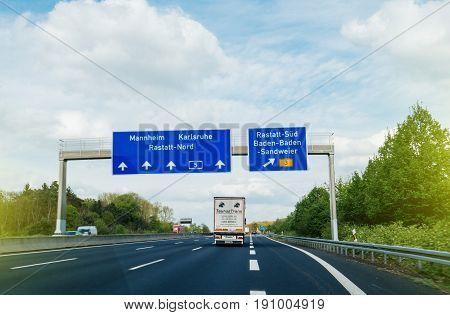GERMANY - APR 13 2017: Bundesautobahn or Federal Motorway highway street signs to Mannheim Karsruhe Rastatt-Nord Baden-Baden and Sandweier truck driving