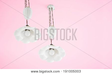Ceramic lamp with white flower shape and beautiful appearance on the ceiling of the pink house. have a clipping path.