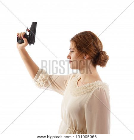 A lady wearing a white dress holding a handgun