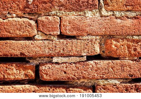 Horizontal bricks in a wall provide a structural background