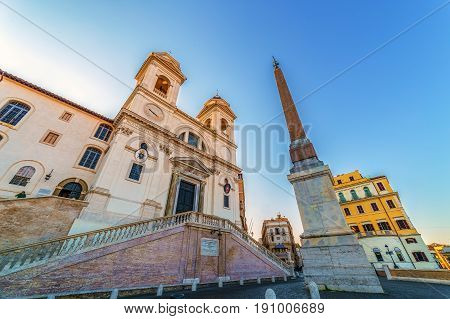 ROME ITALY - MAY 312017: Fish eye view with Church of Trinita dei Monti and Egyptian obelisk on morning light. Roman Catholic and Renaissance church near the Spanish Steps AND Piazza di Spagna.