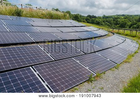 Solar Panels On A Hill Side