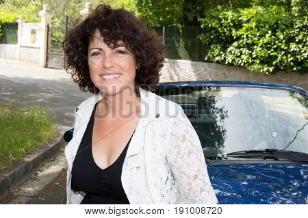 Beautiful Girl Forties With Car In Street In Town
