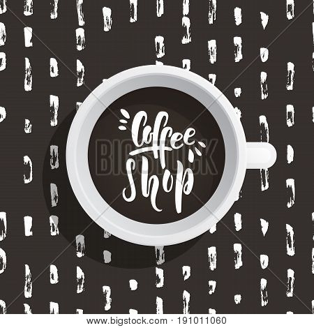 Lettering on the theme of coffee is hand-written. The phrase coffe shop written on the coffee Cup top view