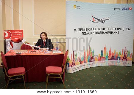 MOSCOW, RUSSIA - JAN 22, 2017: Representative of Turkish Airlines at exhibition Education Abroad for All in Radisson Slavyanskaya Hotel and Business Center.