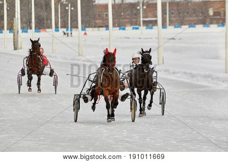 MOSCOW, RUSSIA - JAN 22, 2017: Race on snow-covered Moscow hippodrome on winter day. Central Moscow Hippodrome was founded in 1834.