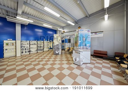 MOSCOW, RUSSIA - MAR 01, 2017: Showroom with samples of production and information at SINIKON factory. The joint Russian-Italian company Sinikon was founded in 1996.
