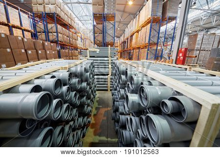 MOSCOW, RUSSIA - MAR 01, 2017: Packages of plastic pipes and cardboard boxes on shelves in factory warehouse. The joint Russian-Italian company Sinikon producing plastic pipes was founded in 1996.