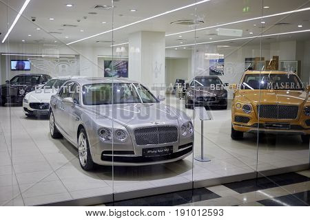 MOSCOW, RUSSIA - JAN 22, 2017: Cars Bentley and Mazerati in showroom in Radisson Slavyanskaya Hotel and Business Center.