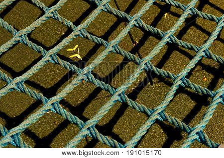 Mesh rope on bright brown background in playground. Rope Mesh.