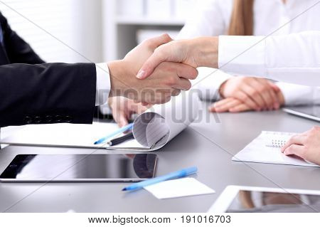Business people shaking hands at meeting. Clouse up of handshake.