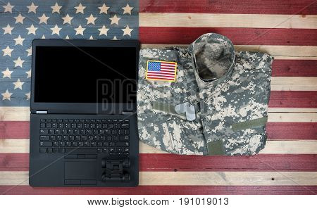 United States military with modern technology on rustic wooden flag