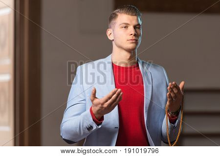 Young Business Man Muslim Praying