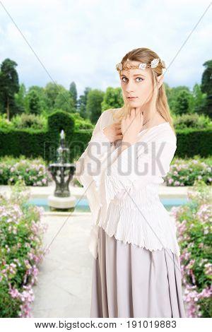 portrait of female elf in her garden