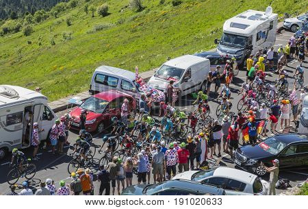 Pas de Peyrol France - July 62016: The peloton riding on the road to Pas de Pyerol (Puy Mary) in Cantal in the Central Massif during the stage 5 of Tour de France on July 6 2016.