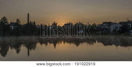 Spring sunrise in Dacice town near pond