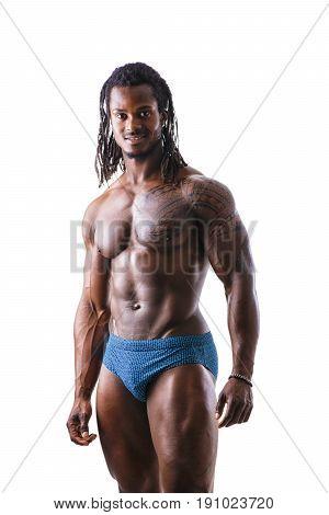 African American bodybuilder man, naked muscular torso, wearing underwear, against black background