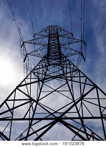 Upward view of an electrical grid tower