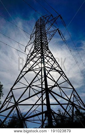 upwards and side view of electrical grid tower