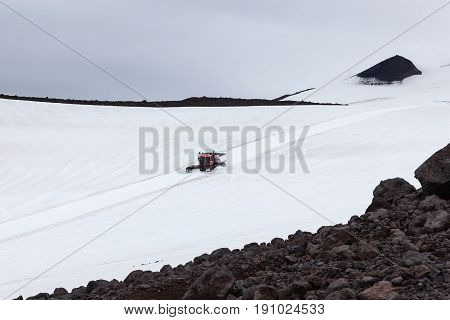 Ratrack Going Down From The Top Of Snaefellsjokull Volcano In Iceland. Tour On The Top Of Volcano In
