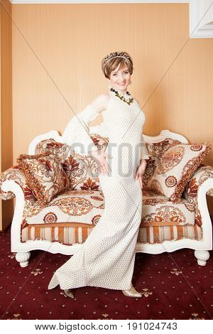 Portrait of attractive brown-haired woman indoors