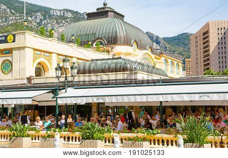 Monaco, Monte Carlo - September 17, 2016: Cafe de Paris with lots of people chilling out in hot a sunny day